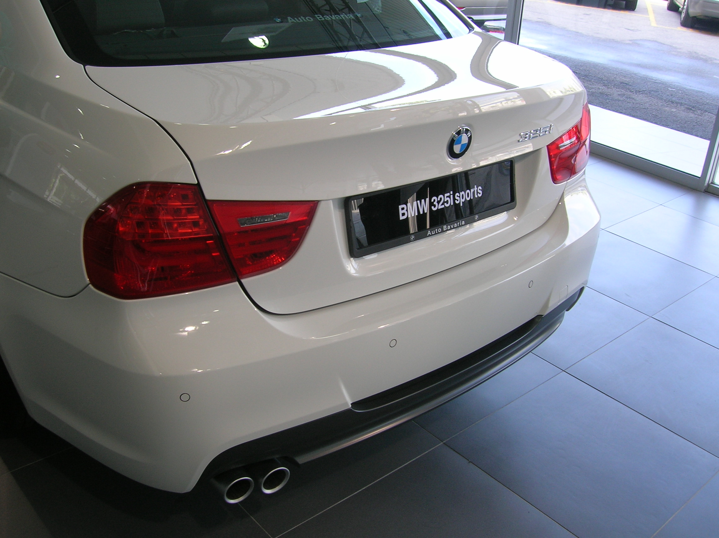New look rear. The E90's original taillights received heavy criticism for being too bland. BMW responded, though I am not sure if the new ones really do look better.