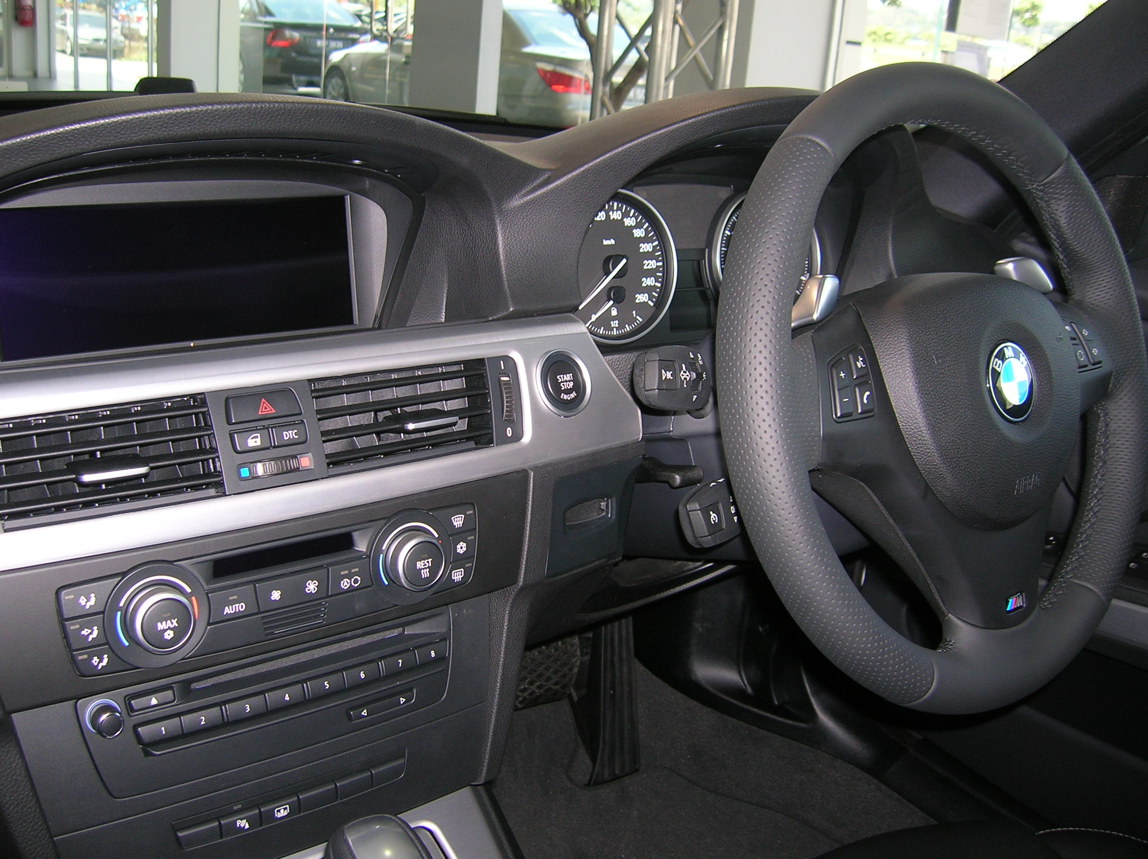 The interior, with M-steering wheel. Paddle-shift controls override for 6-speed Steptronic.