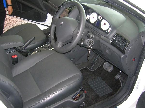 Premium interior, featuring leather seats.