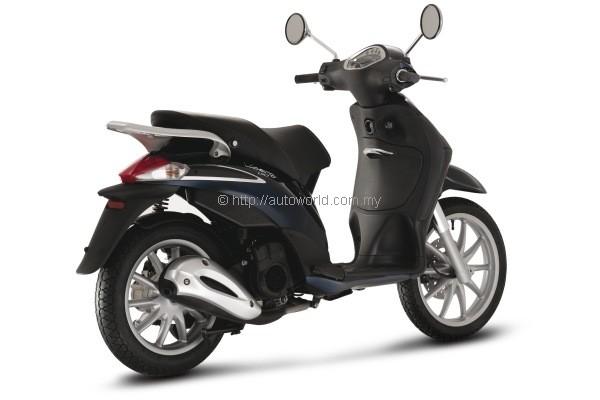 naza launches vespa showroom and piaggio liberty 150cc - autoworld